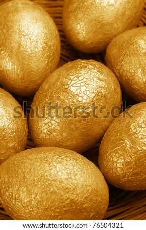 Close-up of crackle golden Easter eggs. - stock photo