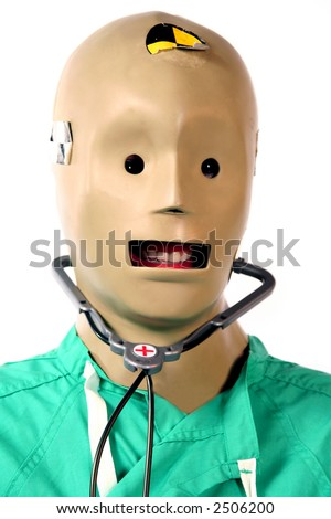 Close-up of crash test dummy in doctors scrubs