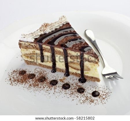 close up of cream cake on white plate - stock photo