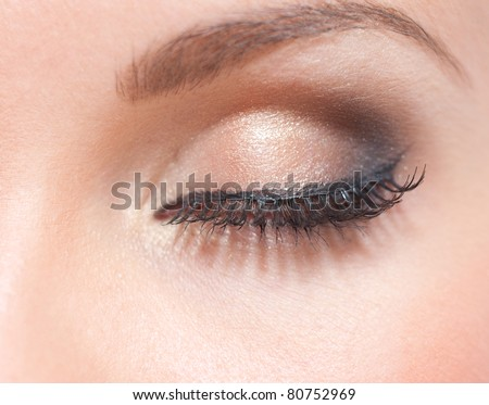 Close up of creative make up on female green eye - stock photo