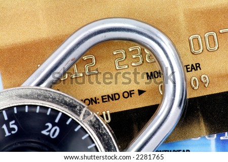 Close up of credit card and lock,  concept of security - stock photo