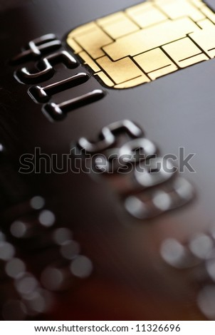 Close-up of credit card - focus on chip,shallow DOF - stock photo