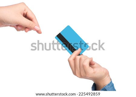Close-up of credit card in humans hand. woman hand holding credit card  - stock photo