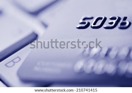 Close up of credit card on a computer keyboard. Concept of Internet purchase  and online shopping. (BW) - stock photo