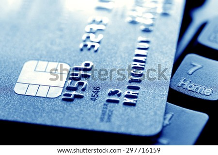 Close up of credit card on computer keyboard - stock photo