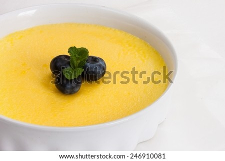 Close up of  Creme Brulee custard with blueberries - stock photo