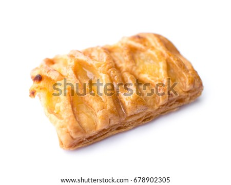 close up of crispy pineapple pie isolated on white background