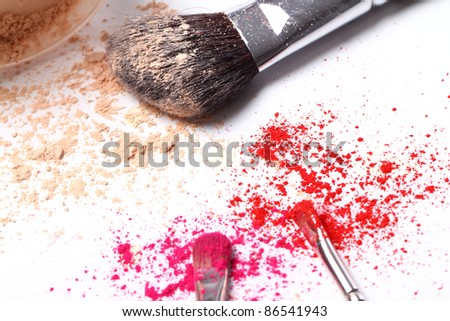 Close up of crumbled colorful eyeshadows - stock photo