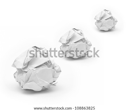 close-up of crumpled paper ball with white background. - stock photo