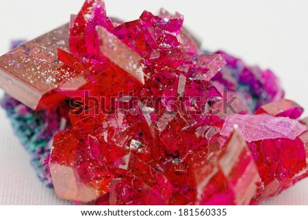 close up of crystals in ruby color on white background (red crystal) - stock photo