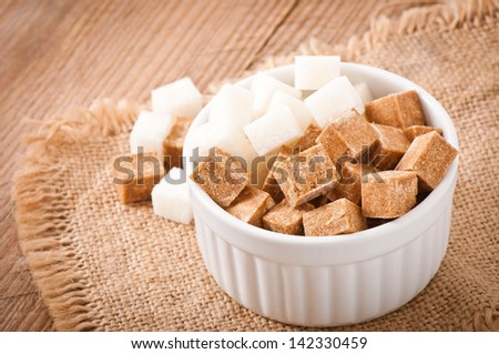 Close-up of cubes of brown and white sugar