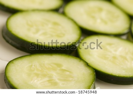 Close up of cucumber slices on white background