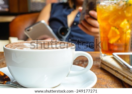 Close up of Cup of Coffee on wooden table in coffee shop - stock photo