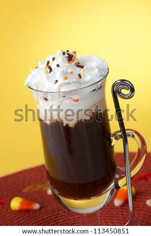 Close up of cup of fresh, delicious Chocolate Vanilla Coffee, and candy corn