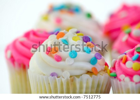 Close up of cupcakes on a white background - stock photo