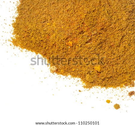 Close-up of curry powder spice isolated on white background - stock photo
