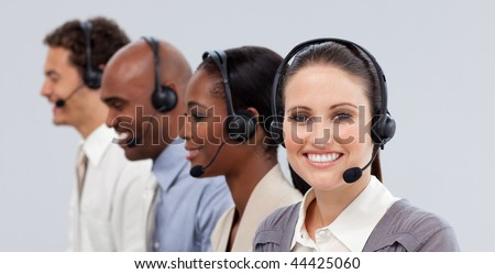 Close-up of customer business representatives with headset on in a call center - stock photo