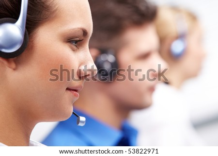 Close-up of customer support representative with headset during work - stock photo
