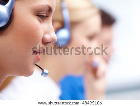 Close-up of customers representative with headset in line during work - stock photo