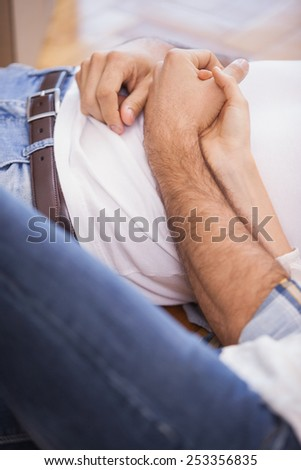 Close up of cute couple lying on the floor in their new home - stock photo