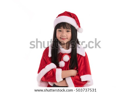 Close up of cute litlle asian girl in santaclaus suit on white background isolated.