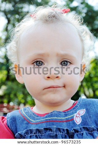 Close-up of cute little baby face - stock photo
