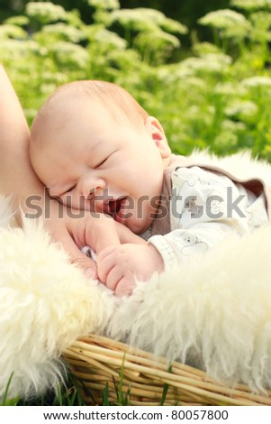Close-up of cute small boy with mother hand