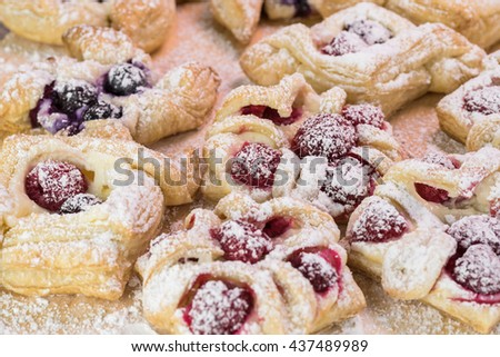 Close up of cutting board with fresh baked berries cream cheese pastries.