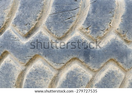 Close-up of damaged heavy dump truck tyre - stock photo