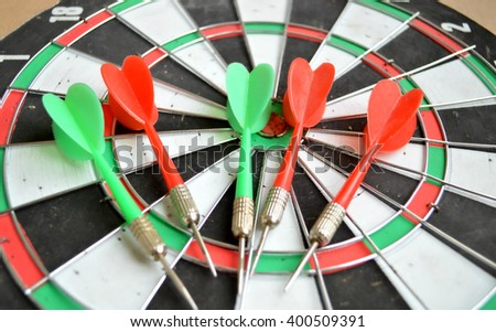Close-up of darts arrows in the target center. Smart goal setting, dart hit the center of dartboard. Hit to the point. Business concept. -  - stock photo