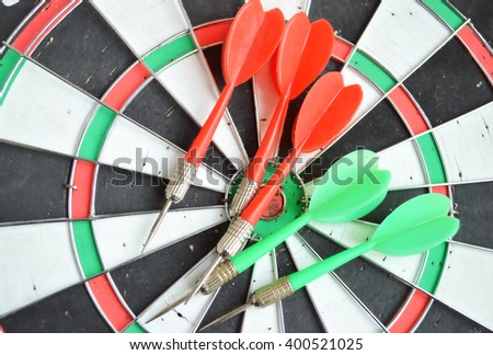 Close-up of darts arrows in the target center. Smart goal setting, dart hit the center of dartboard. Hit to the point. Business concept.