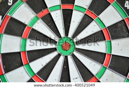 Close-up of darts arrows in the target center. Smart goal setting, dart hit the center of dartboard. Hit to the point. Business concept.  - stock photo