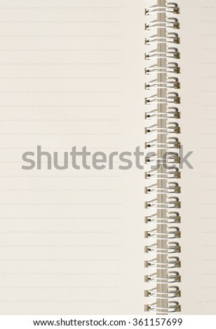 Close up of dash line notebook paper with white spiral wire. - stock photo