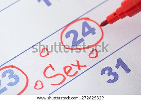 Close-up Of Date Marked With Red Pen For Sex On Calendar - stock photo