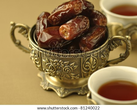 Close up of  dates and black tea - stock photo