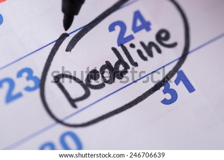 Close-up Of Deadline Written On Date With Black Marker - stock photo