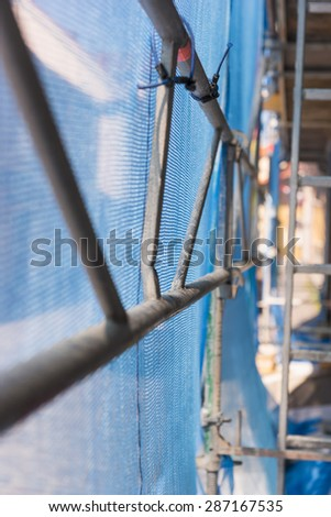 Close up of debris netting on scaffolding, seen from inside - stock photo