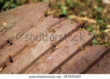 Close up of decay  tin roof. - stock photo