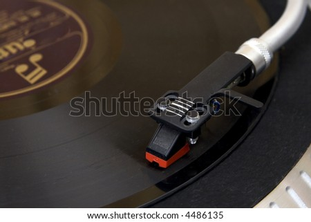 Close up of deck record and needle. - stock photo