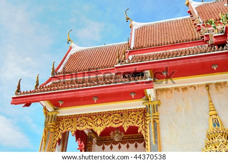 Close-up of decorated roof of buddhist temple in Phuket island in Thailand - stock photo