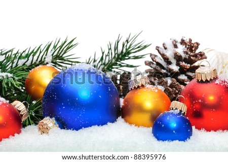 Close up of decorative Christmas balls, strobile and Christmas tree on the snow. - stock photo