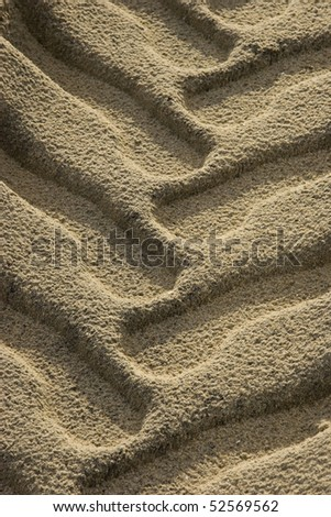 Close up of deep tire tracks in beach sand. - stock photo