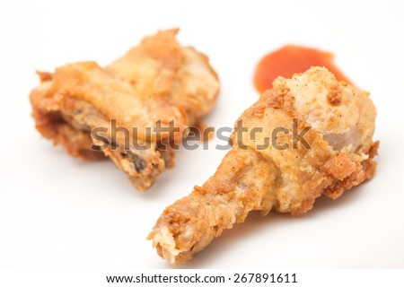 Close up of delicious and crispy chicken drum stick on white for food background - stock photo