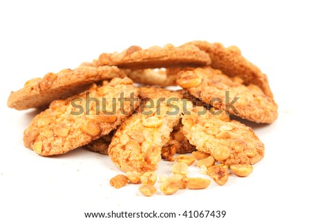 Close up of delicious biscuits with peanuts, isolated on white background - stock photo