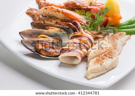Close up of delicious grilled seafood platter - stock photo