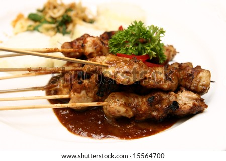 Close-up of delicious Indonesian chicken satay. - stock photo