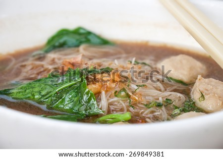 Close up of delicious local Thai noodle with pork meat ball for food background - stock photo