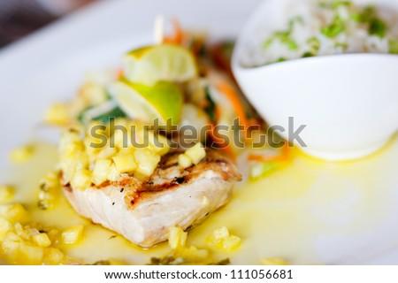 Close up of delicious mahi mahi fish dish - stock photo