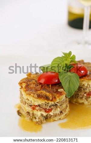 Close up of delicious meat pie served in elegant restaurant. Traditional food. Very shallow depth of field for soft background/Restaurant meal - stock photo