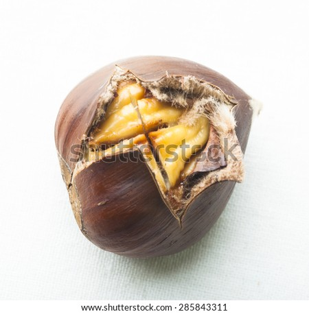 Close-up of delicious roasted chestnut on white background - stock photo